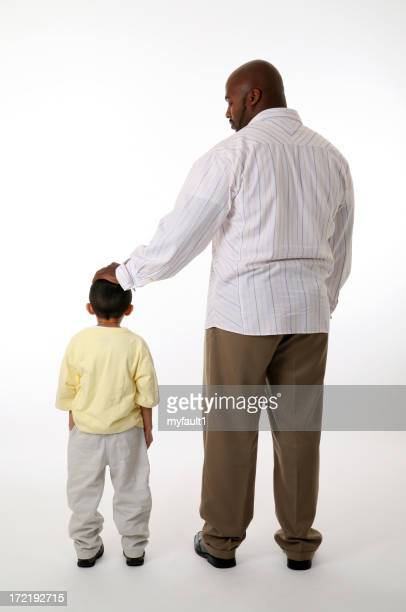 Father pats son's head