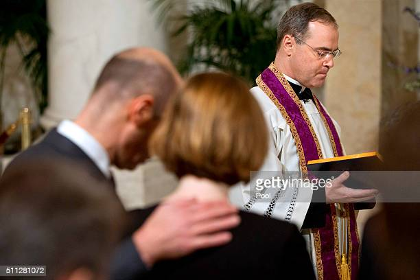 Father Paul Scalia leads a prayer during a private ceremony for his father Justice Antonin Scalia during a private ceremony in the Great Hall of the...