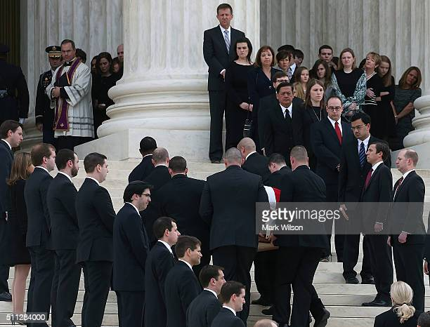 Father Paul Scalia son of Associate Justice Antonin Scalia watches as his fathers casket is carried up the steps of the Supreme Court building...