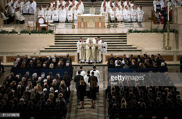 Father Paul Scalia son of Justice Antonin Scalia leads the funeral Mass for Associate Justice Antonin Scalia at the Basilica of the National Shrine...