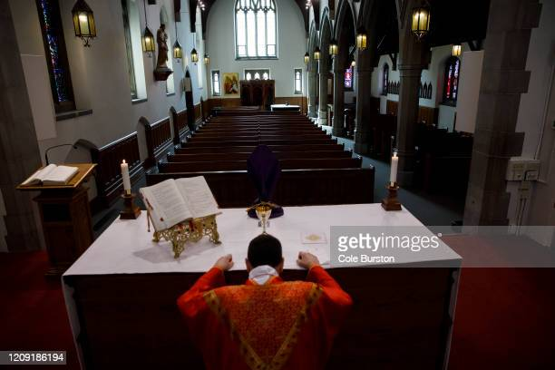 Father Peter Turrone leads a Palm Sunday mass to an empty church at the St Thomas Aquinas Catholic Church on April 5 2020 in Toronto Canada Ontario...
