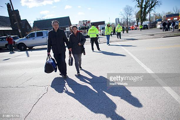 A father picks up his daughter who survived the Amtrak Palmetto train 89 crash on April 3 2016 in Chester Pennsylvania Two people are confirmed dead...