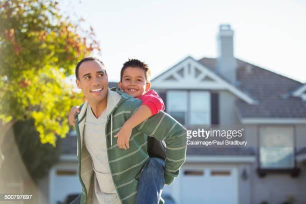Father piggybacking son outdoors