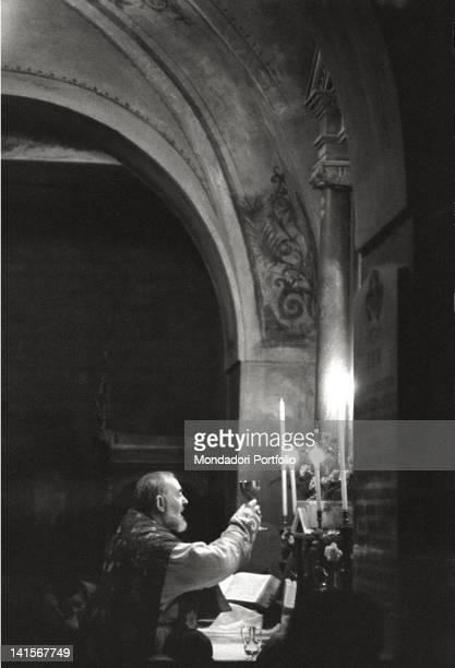 Father Pio of Pietrelcina celebrates mass at the convent of San Giovanni Rotondo Italy