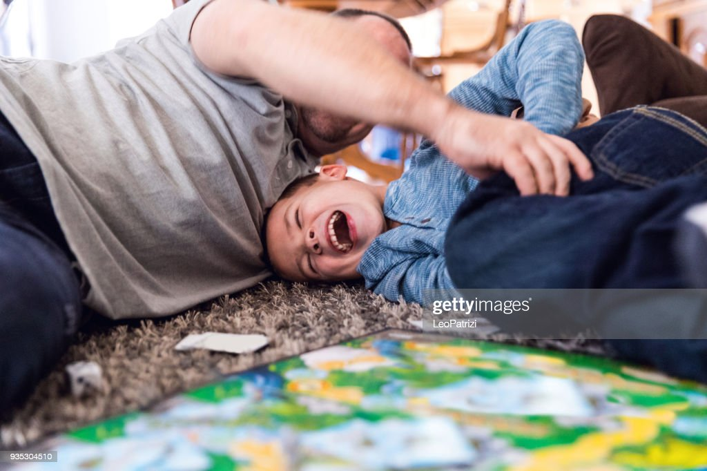 Father play at home with son : Stock Photo