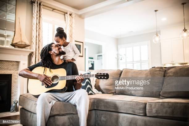 father playing guitar with children near - musical instrument stock pictures, royalty-free photos & images