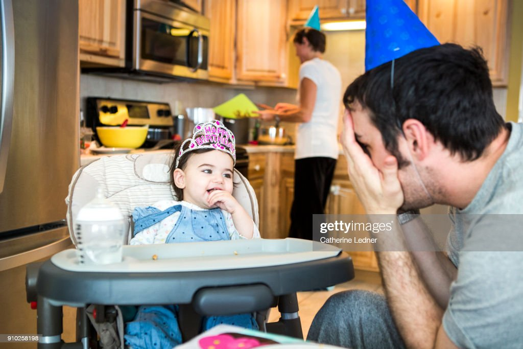 Father Playing Peekaboo With One Year Old In High Chair Happy Birthday Crown Stock