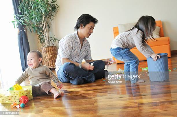 Father Playing Together with Daughters