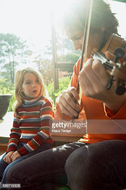 Father playing violin