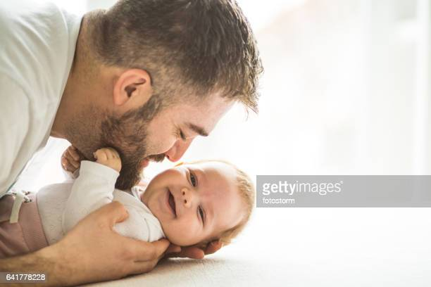 Father playing with baby girl