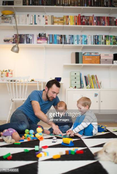 Father playing with children