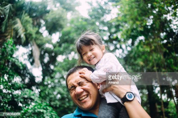 father playing with daughter - asia stock pictures, royalty-free photos & images