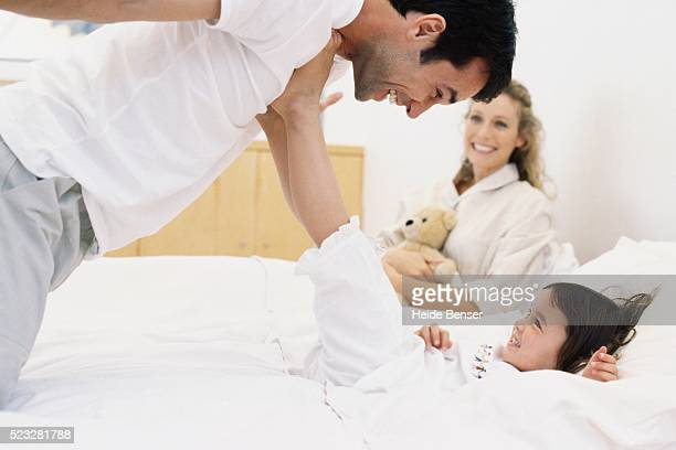 Father playing with daughter