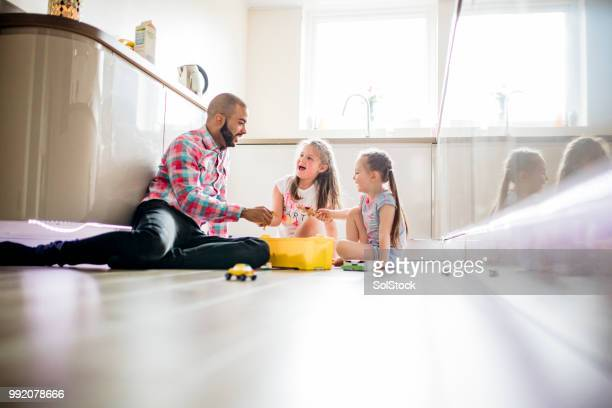 father playing with his children at home - divorce kids stock pictures, royalty-free photos & images