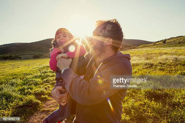 father playing with his daughter outdoor - innocence stock pictures, royalty-free photos & images