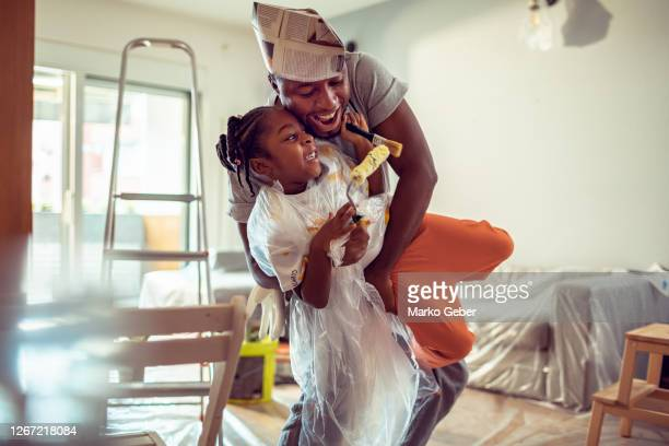 father playing with his daughter - renovation stock pictures, royalty-free photos & images