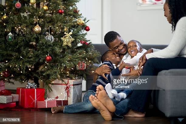 Father Playing with His Kids on Christmas Day