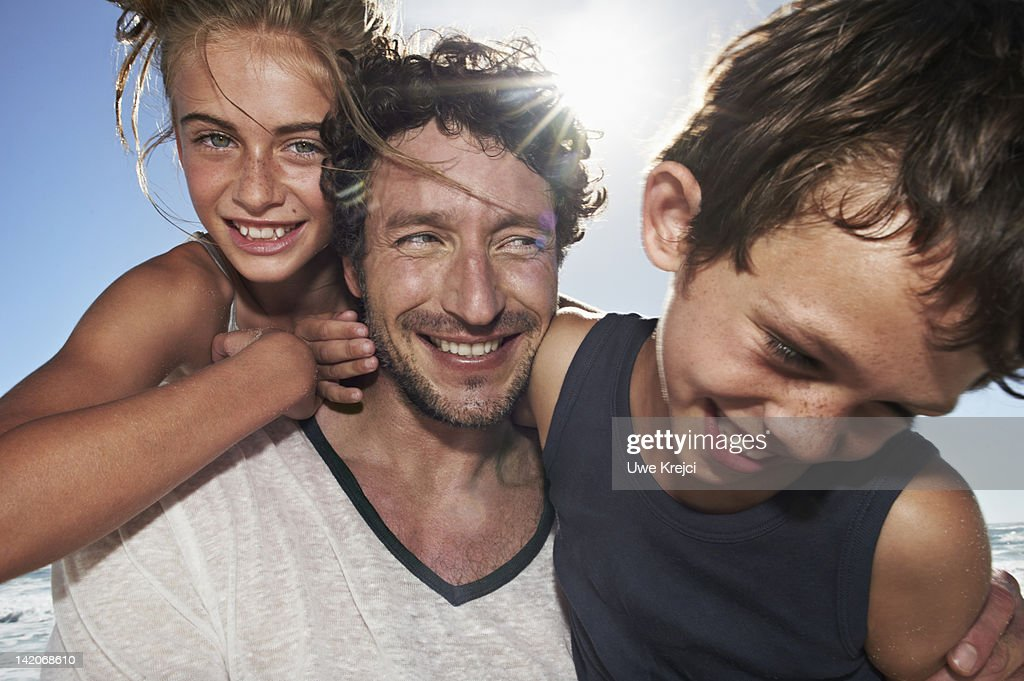 Father playing with son and daughter : Stock Photo