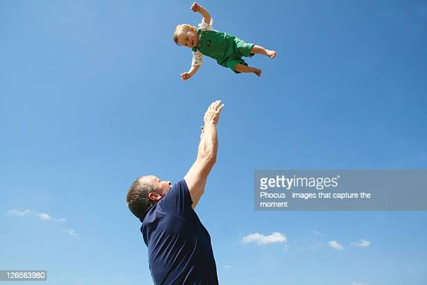 father playing with son - catching stock pictures, royalty-free photos & images