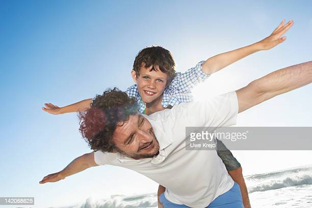 Father playing with son (6 - 8 years)