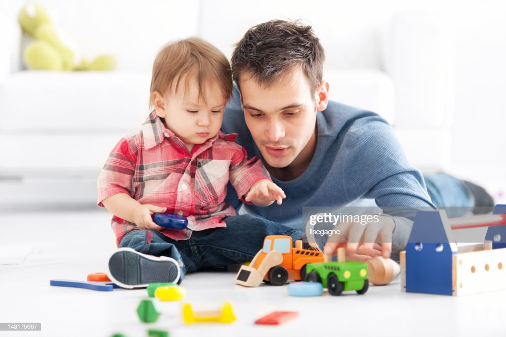 Father playing with son : Stock Photo