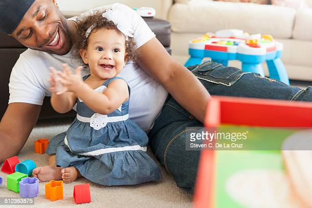 Father playing with young daughter