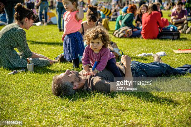 A father plays with his daughter during the protest Thousands of parents and students took part in the March through Edinburgh as part of the global...
