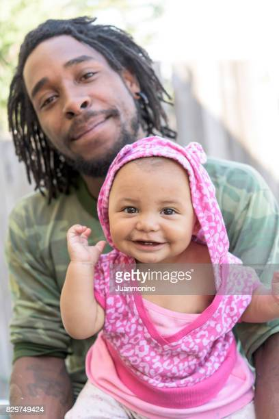 father posing with his daughter - afro caribbean ethnicity stock pictures, royalty-free photos & images