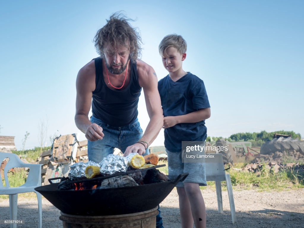 Father preparing food with his son : Stock Photo