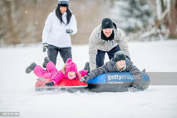 Father Pushing Kids on an Inner Tube