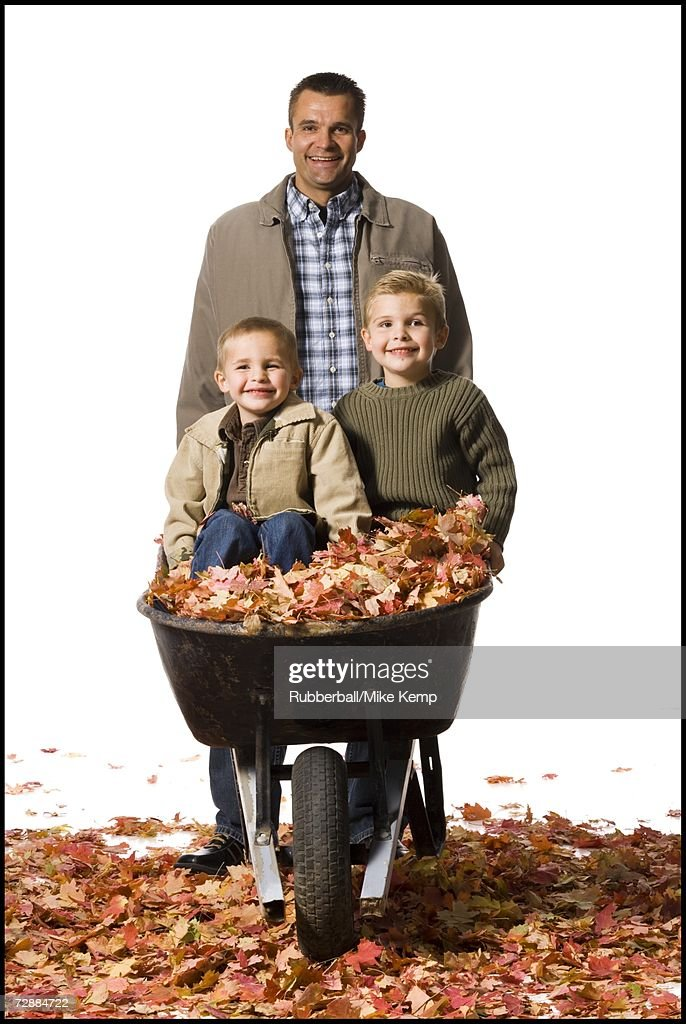 Father Pushing Two Sons In A Wheelbarrow Stock Photo Getty