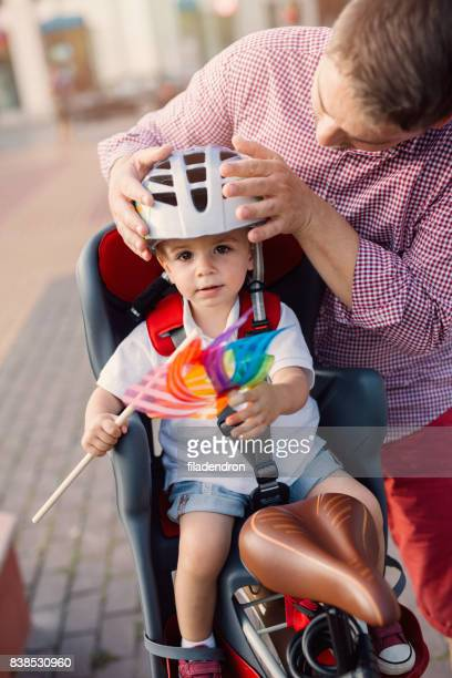 Father putting a helmet on his son's head