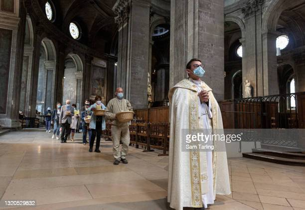 Father Raphael Cournault leads a service in memory of those who died of COVID-19 on May 28, 2021 in Paris, France. The service was held in Saint...