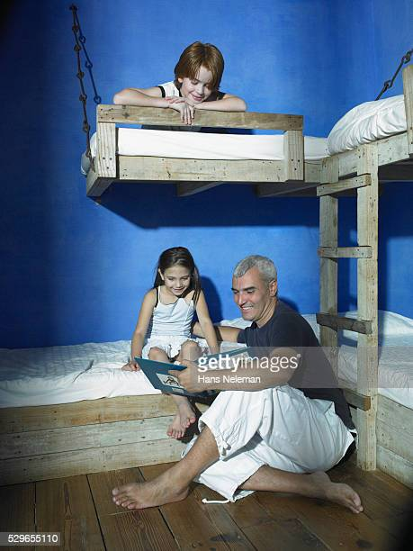 Father Reading Bedtime Story to Children