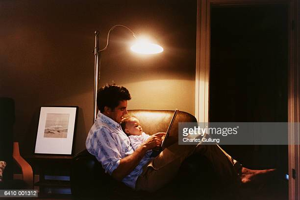 father reading to baby - electric lamp stock pictures, royalty-free photos & images