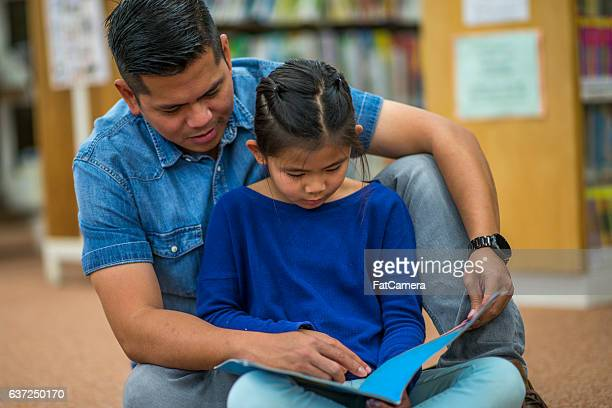 Father Reading to His Daugther