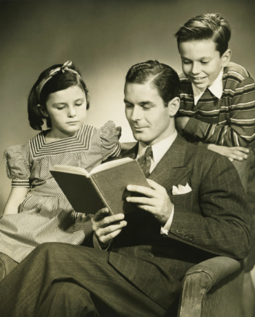 Father reading to son (4-5) and daughter ( 6-7) in studio, (B&W), portrait - gettyimageskorea