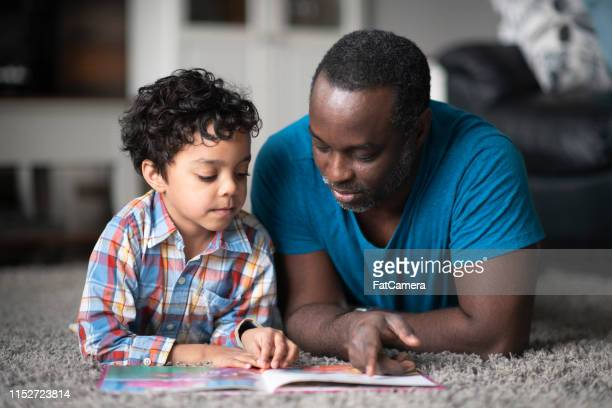 father reading to son - reading stock pictures, royalty-free photos & images