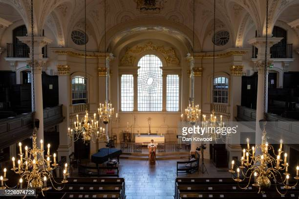 Father Richard Carter live streams a Eucharist service from St MartinintheFields on May 20 2020 in London England References to a church on the site...