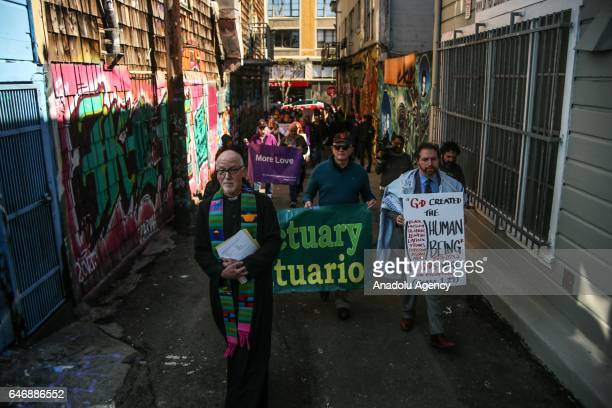Father Richard Smith and Rabbi Michael Rothbaum march with community members through the Mission District during an Ash Wednesday procession in San...