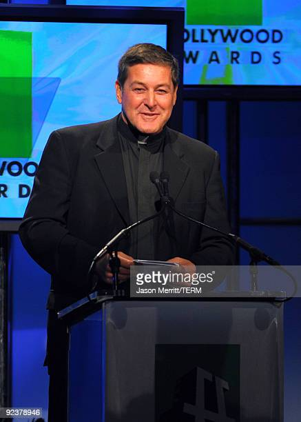 Father Rick Frechette accepts the Hollywood Humanitarian Award onstage during the 13th annual Hollywood Awards Gala Ceremony held at The Beverly...