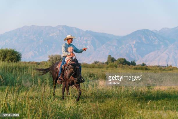 father riding a horse with his young daughter - ranch stock pictures, royalty-free photos & images