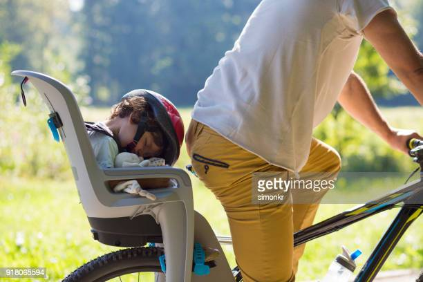 father riding bicycle in park - family with one child stock pictures, royalty-free photos & images