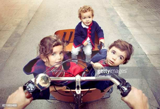 Father riding cargo bike