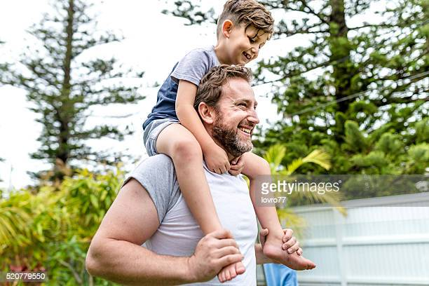 Father riding son on shoulder