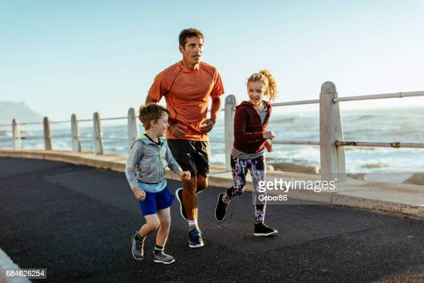 Father running with kids
