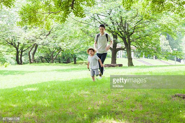 Father running with the child in the park