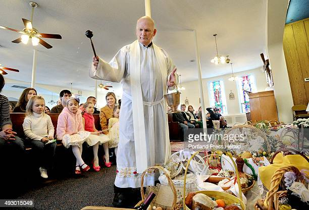 Father Ryszard Filipowski blesses Easter Baskets at St Louis Catholic Church in Portland Sat March 30 2013