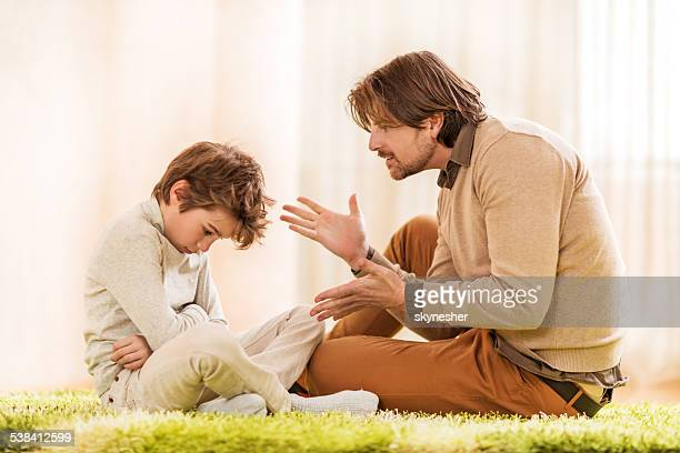 father scolding his son. - scolding stock pictures, royalty-free photos & images