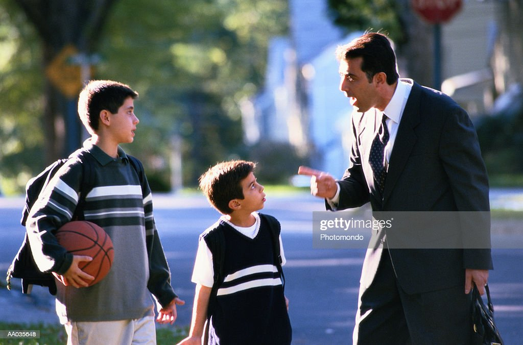Father Scolding His Two Sons : Stock Photo
